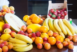 Heap of various fresh fruits at table in home kitchen